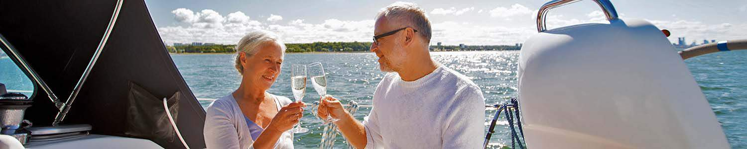 Older Couple on Romantic Charter Enjoying a Glass of Wine